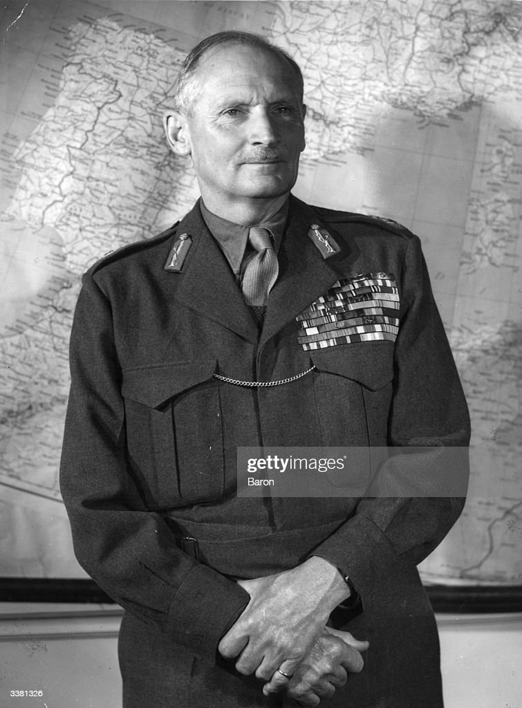 Viscount Montgomery of Alamein, Bernard L. Montgomery, (1887 - 1976) stands in army uniform with hands crossed before a map of Europe, 1950.