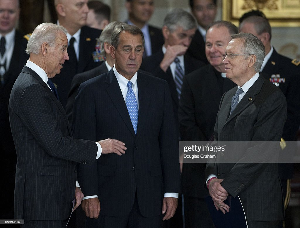 Vise President Joe Biden, Speaker of the House John Boehner, R-OH., and Senate Majority Leader Harry Reid, D-NV., talk before the flag is draped casket of U.S. Senator Daniel Inouye (D-HI) enters the Rotunda of the U.S. Capitol where he will lie in state December 20, 2012 on Capitol Hill in Washington, DC. The late Senator had died at the age of 88 on Monday at the Walter Reed National Military Medical Center in Bethesda, Maryland where he had been hospitalized since early December. A public funeral service will be held at the Washington National Cathedral on Friday for Senator Inouye, a World War II veteran and the second-longest serving senator in history. His remains will be returned and laid to rest in his home state.