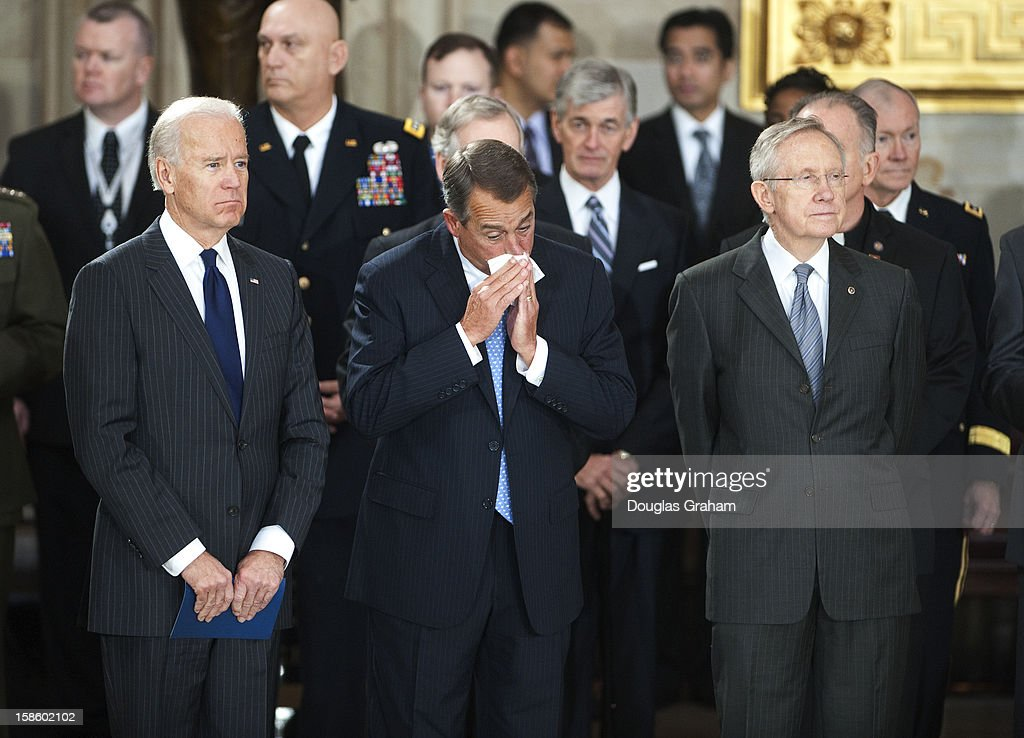 Vise President Joe Biden, Speaker of the House John Boehner, R-OH., and Senate Majority Leader Harry Reid, D-NV., watch as the flag is draped casket of U.S. Senator Daniel Inouye (D-HI) enters the Rotunda of the U.S. Capitol where he will lie in state December 20, 2012 on Capitol Hill in Washington, DC. The late Senator had died at the age of 88 on Monday at the Walter Reed National Military Medical Center in Bethesda, Maryland where he had been hospitalized since early December. A public funeral service will be held at the Washington National Cathedral on Friday for Senator Inouye, a World War II veteran and the second-longest serving senator in history. His remains will be returned and laid to rest in his home state.