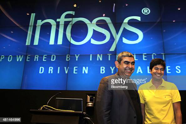 Vishal Sikka chief executive officer of Infosys Ltd left and Rajiv Bansal chief financial officer attend a news conference at the company's...