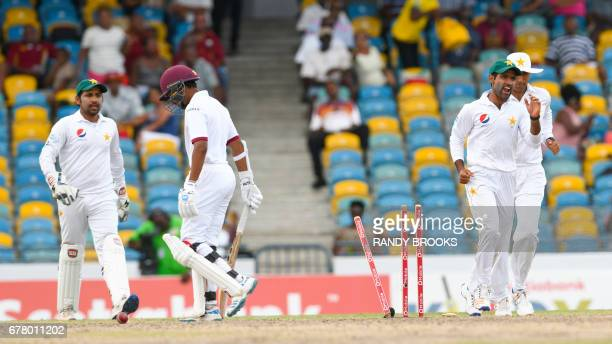 Vishal Singh of West Indies bowled as Sarfraz Ahmed Asad Shafiq and Younis Khan of Pakistan celebrate during the 4th day of the 2nd Test match...