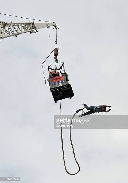 A visiitor bungee jumps during an outdoor festival to celebrate German Unity Day on the 21st anniversary of German reunification on October 3 2011 in...
