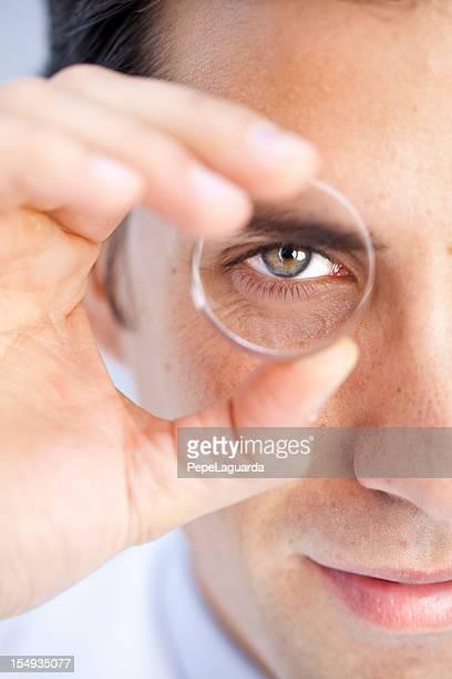 Vision: man looking through a lens