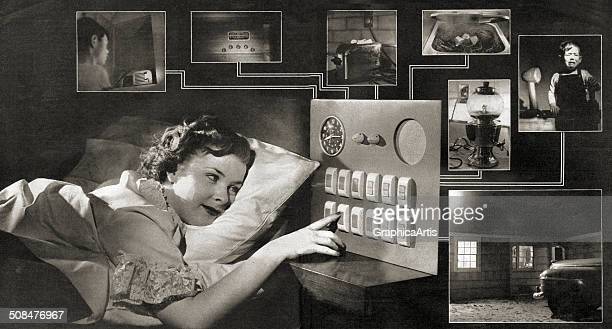 Vision of the Future' vintage illustration of a housewife resting in bed and running her household with the push of a button 1949 The modern...