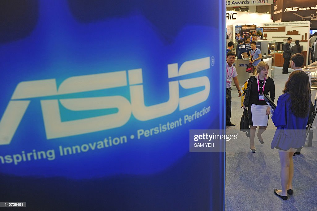 Visiotrs walk past a ASUS logo during the Computex 2012 in Taipei on June 5, 2012. Computex is Asia's leading IT trade fair. AFP PHOTO / Sam YEH