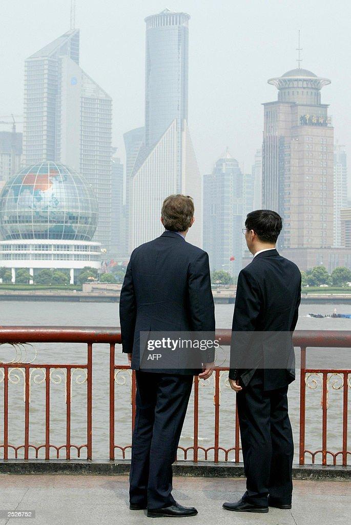 Visiting British Prime Minister Tony Blair and Shanghai Mayor Han Zheng look towards Pudong financial district 22 July 2003 Blair wraps up his China...