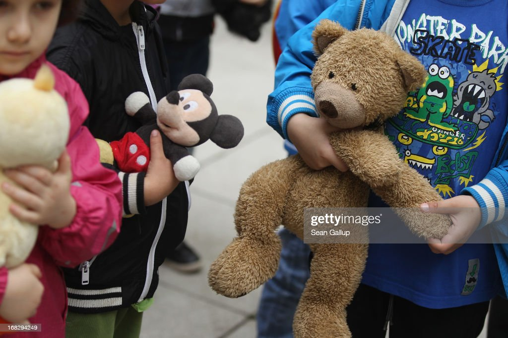 Visiting children wait with their stuffed animals to have them diagnosed at the Teddy Bear Clinic at Charite Hospital on May 8, 2013 in Berlin, Germany. Charite Hospital hosts the annual Teddy Bear Clinic days and invites children from Berlin day care centers to bring their injured teddy bears for fictitious examinations, x-rays, surgery and healing as a way for small children to become acquainted with a medical environment.