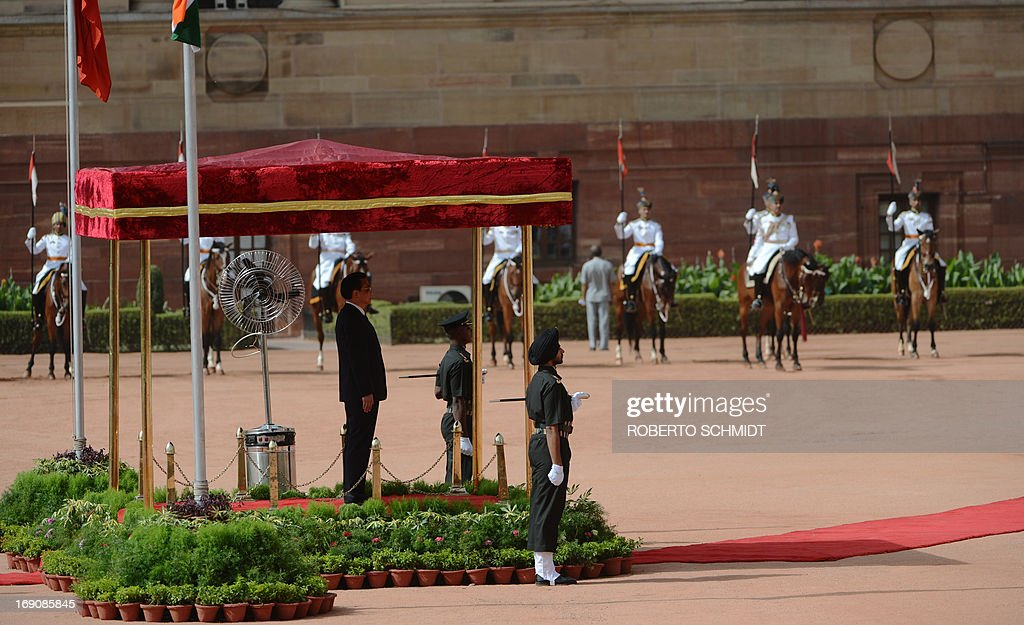 Visiting Chinese Premier Li Keqiang listens to the Chinese and Indian national anthems during his official welcoming ceremony at Rashtrapati Bhavan - The Presidential Palace in New Delhi on May 20, 2013. Kequiang pledged to build 'mutual trust' with India.