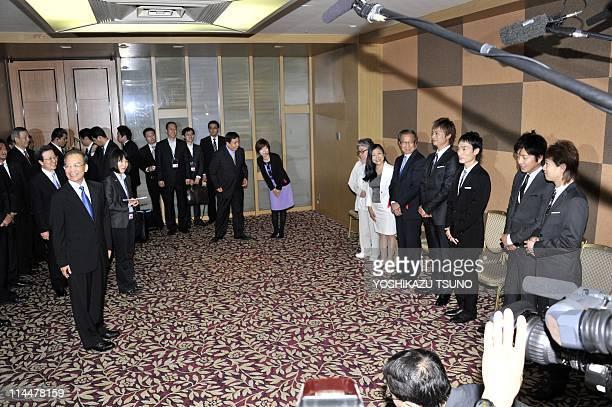 Visiting Chinese Prime Minister Wen Jiabao smiles as Japanese pop group SMAP members Masahiro Nakai Takuya Kimura Tsuyoshi Kusanagi and Shingo Katori...