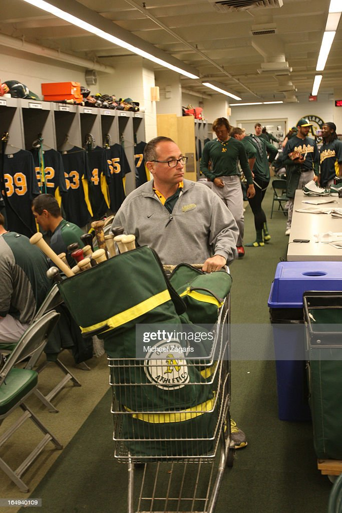 Visiting Clubhouse Manager Mike Thalblum of the Oakland Athletics gets equipment together during a spring training workout at Phoenix Municipal Stadium on February 28, 2013 in Phoenix, Arizona.