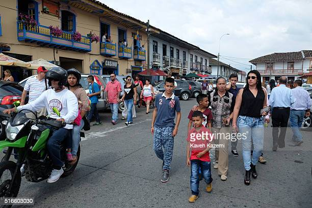 Visiting Colombians seen on a Sunday afternoon in the main town square on January 24 2016 in Filandia Colombia Filandia is a town and municipality in...