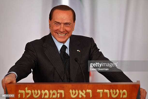 Visiting Italian Prime Minister Silvio Berlusconi listens as his Israeli counterpart and host Benjamin Netanyahu addresses a press conference...