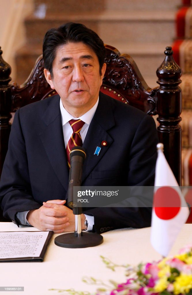 Visiting Japanese Prime Minister Shinzo Abe speaks during a joint press conference held after official talks with his Vietnamese counterpart Nguyen Tan Dung in Hanoi on January 16, 2013. Abe is here for a one-day official visit, the first leg of an Southeast Asian trip which will lead him also to Indonesia and Thailand. AFP PHOTO/POOL/LUONG THAI LINH