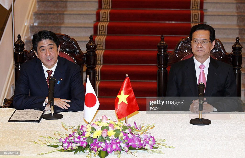 Visiting Japanese Prime Minister Shinzo Abe (L) speaks next to his Vietnamese counterpart Nguyen Tan Dung during a joint press conference held after their official talks in Hanoi on January 16, 2013. Abe is here for a one-day official visit, the first leg of an Southeast Asian trip which will lead him also to Indonesia and Thailand.