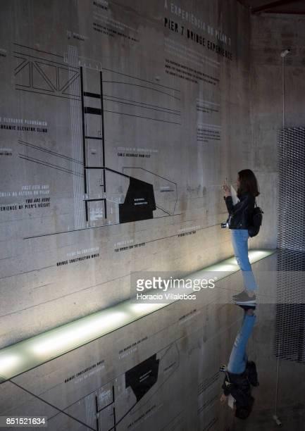 A visiting journalist seen observing a diagram of Pier 7 of 25 de Abril bridge site of the 'Experiencia Pilar 7' an interpretive center of the bridge...