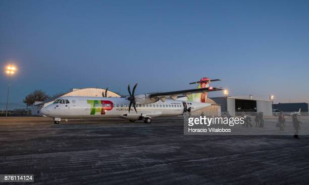 Visiting journalists get off a White Airways ATR 72'u2013600 airplane the company flies for TAP Express in Evora Municipal airport during the first...