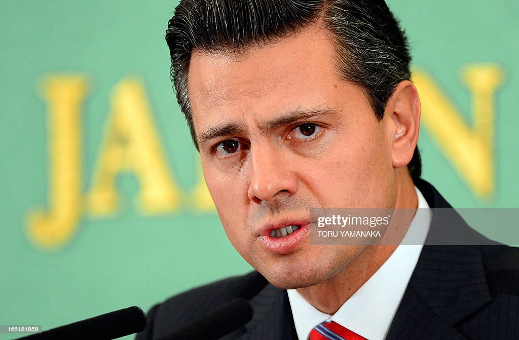 Visiting Mexican President Enrique Pena Nieto answers questions during a press conference in Tokyo on April 10, 2013. President Nieto is on a four-day visit to Japan aimed at deepening economic ties. AFP PHOTO / Toru YAMANAKA