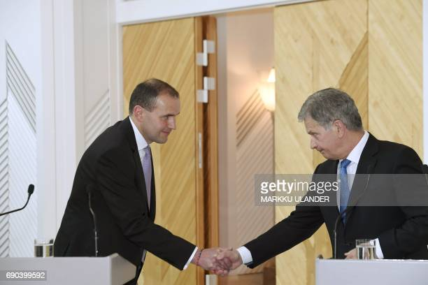 Visiting President of Iceland Gudni Johannesson and his Finnish counterpart Sauli Niinistö shake hands following a joint press conference at the...