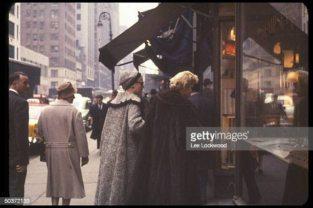 Visiting Princess Grace of Monaco formerly actress Grace Kelly windowshopping with mother Mrs John B Kelly both seen from the back