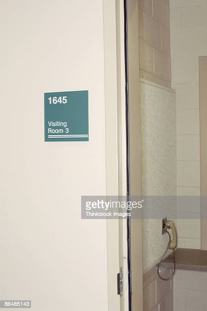 Visiting room doorway and sign