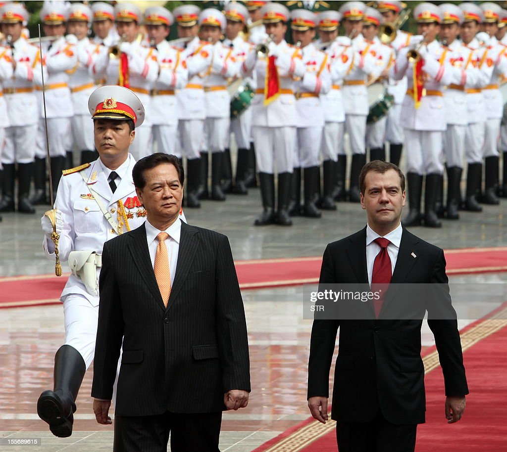 Visiting Russian Prime Minister Dmitri Medvedev (R) and his Vietnamese counterpart Nguyen Tan Dung review an honour guard during a welcoming ceremony at the presidential palace in Hanoi on November 7, 2012. Medvedev is on a two-day official visit to the former Southeast Asian communist ally after he attended the 9th summit Asia-Europe (ASEM 9) which ended in Vientiane on November 6, 2012.
