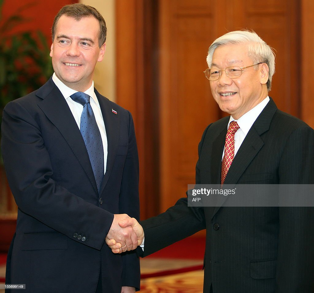 Visiting Russian Prime Minister Dmitri Medvedev (L) shakes hands with Vietnamese Communist Party's Secretary General Nguyen Phu Trong in Hanoi on November 7, 2012. Medvedev is on a two-day official visit in its former Southeast Asian communist ally after he attended the 9th summit Asia-Europe (ASEM 9) which ended in Vientiane, Laos on November 6.