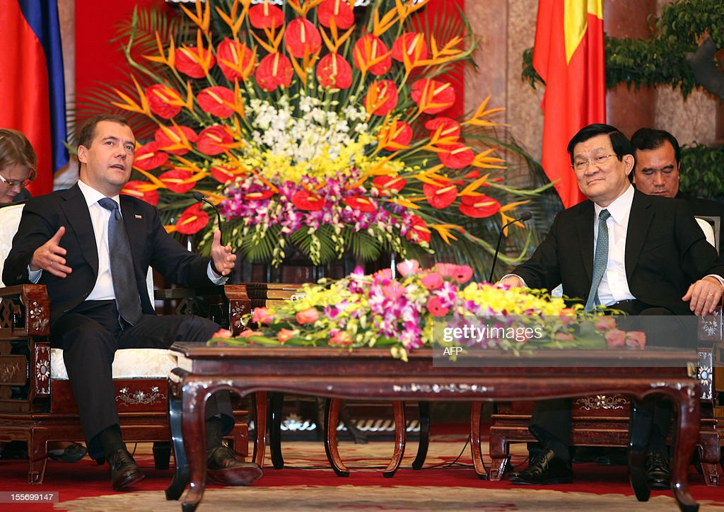 Visiting Russian Prime Minister Dmitri Medvedev (L) talks with Vietnamese President Truong Tan Sang at the presidential palace in Hanoi on November 7, 2012. Medvedev is on a two-day official visit in its former Southeast Asian communist ally after he attended the 9th summit Asia-Europe (ASEM 9) which ended in Vientiane, Laos on November 6.