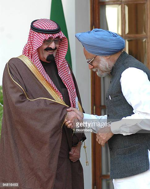 Visiting Saudi King Abdullah bin Abdul Aziz alSaud left is greeted by Indian Prime Minister Manmohan Singh in New Delhi India Wednesday January 25...