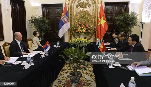 Visiting Serbian Foreign Minister Ivan Mrkic holds talks with his Vietnamese counterpart Pham Binh Minh in Hanoi on March 1 2013 The Serbian diplomat...