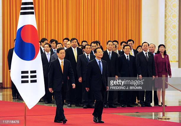 Visiting South Korean Prime Minister Kim HwangSik walks beside his Chinese counterpart Wen Jiabao during a welcoming ceremony at the Great Hall of...