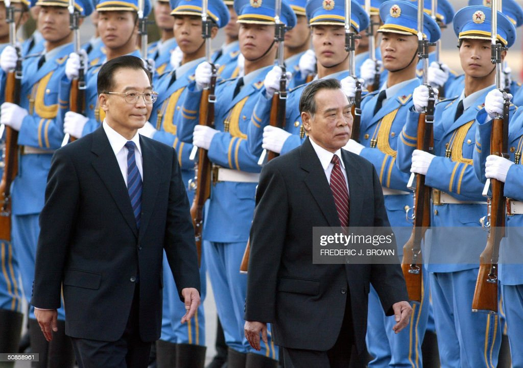 Visiting Vietnamese Prime Minister Phan Van Khai (R) walks beside Chinese Premier Wen Jiabao during a review of the honour guard at the Great Hall of the People, 20 May 2004 in Beijing, after arriving in the Chinese capital earlier today. AFP PHOTO/Frederic J. BROWN
