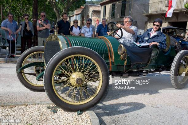 A visiting vintage car leaves a French village during a threeday rally journey through the Corbieres wine region on 26th May in Lagrasse...