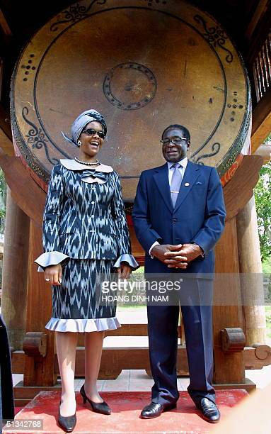 Visiting Zimbabwean President Robert Mugabe and his wife Grace stand next to a big drum during their visit 29 September 2001 at the Temple of...
