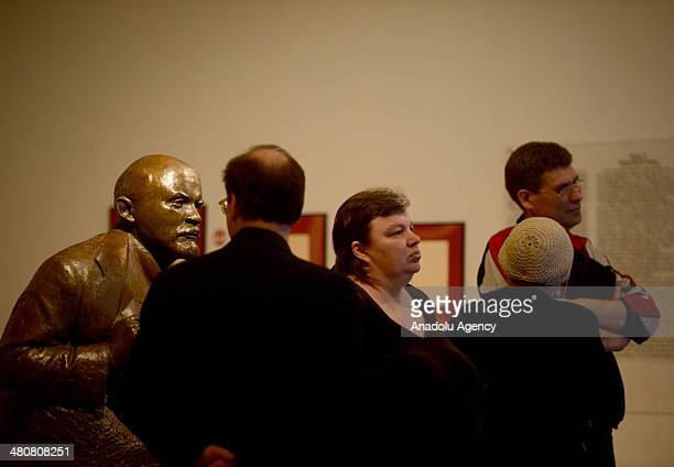 Visitiors observe sculptures of Lenin and Stalin displayed during the 'Legendary Leaders' sculpture exhibition at the State History Museum in Moscow...
