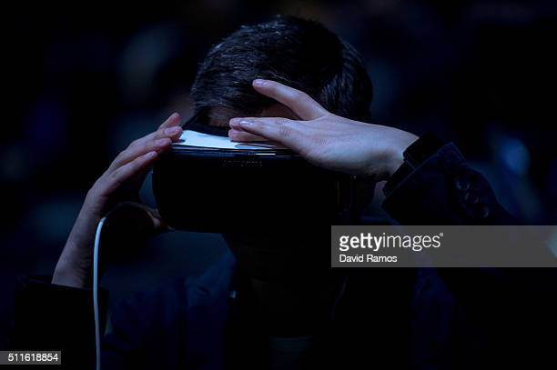 A visitor adjusts his a Samsung Gear VR device during the presentation of the new Samsung Galaxy S7 and Samsung Galaxy S7 edge on February 21 2016 in...