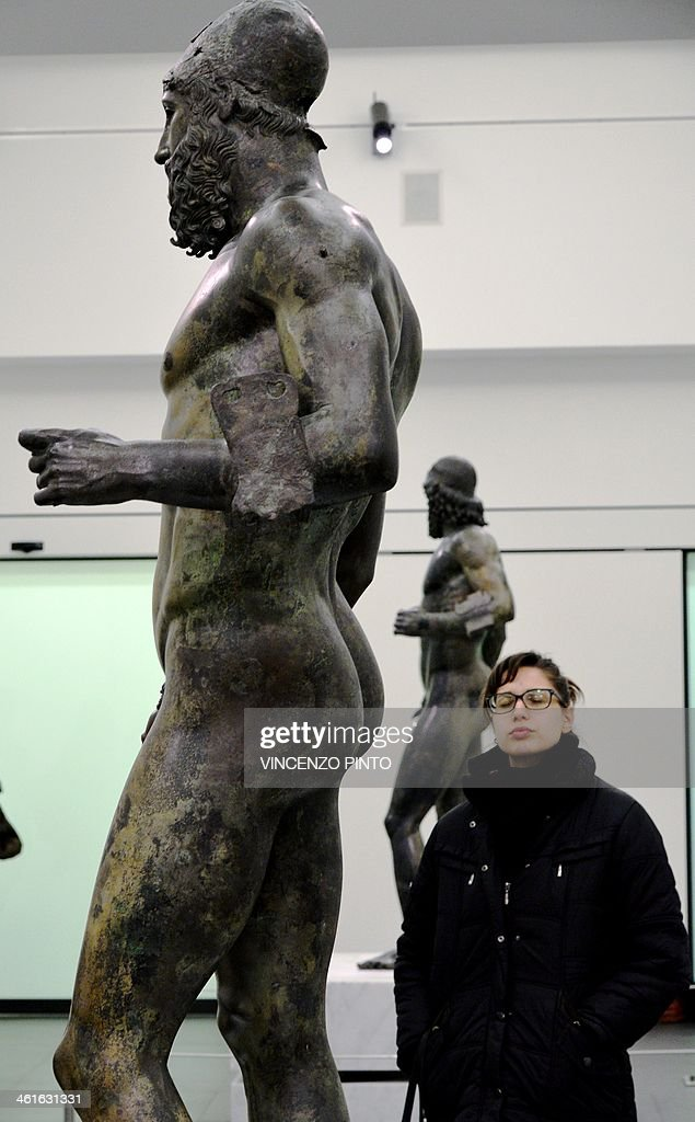 Visitor admire the 2500yearold Riace Bronzes displayed in a renovated Reggio Calabria National Archeological Museum on January 9 following four years...
