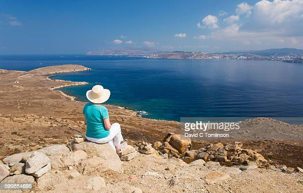 Visitor admiring view from Mount Kynthos, Delos