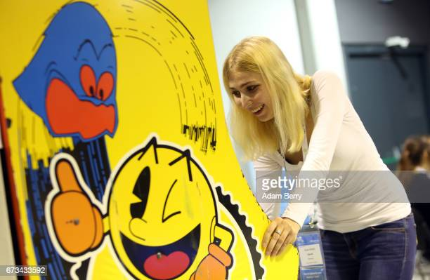Visitor Alina Ullrich plays a vintage PacMan video game at the Making Games conference during International Games Week on April 26 2017 in Berlin...