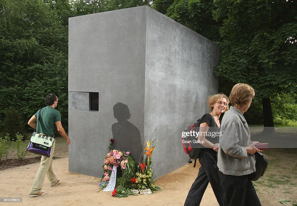 A visitor approaches the window of the newly-inaugurated memorial to homosexual victims of the Nazis on May 27, 2008 in Berlin, Germany. The memorial, a large stone with a window that looks onto an image of two men kissing, commemorates the tens of thousands of gays imprisoned by the Nazis, including the estimated 15,000 sent to concentration camps. The memorial stands in the Tiergarten park close the to Holocaust Memorial.