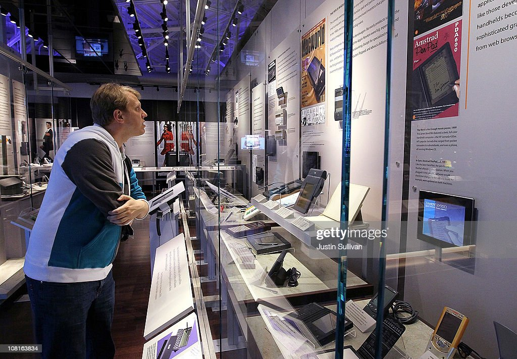 A visitor at the Computer History Museum looks at a display of hand held computers on January 19, 2011 in Mountain View, California. After a two year, $19 million renovation, the Computer History Museum re-opened its doors with a new 25,000 square foot exhibit called Revolution: The First 2000 Years of Computing. The exhibit features over 1,000 artifacts and 100 multimedia stations that explores every major aspect of the history of computing, from the abacus to the smart phone, and every step in between.