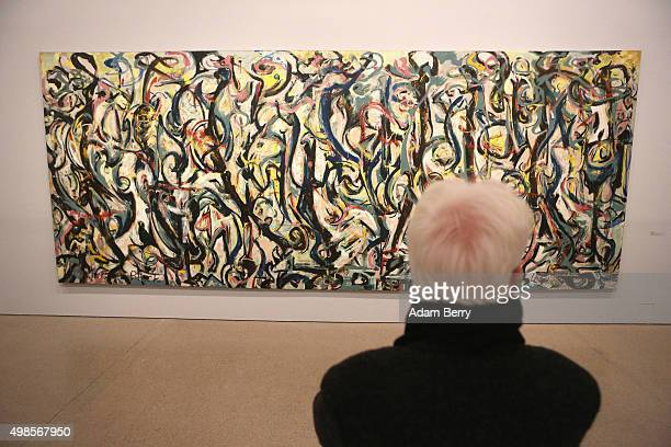 A visitor at the 'Jackson Pollock's Mural Energy Made Visible' exhibition looks at Jackson Pollock's work entitled 'Mural' at the Deutsche Bank...