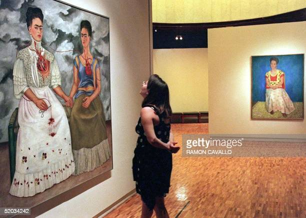 A visitor at the Modern Art Museum of Mexico City looks at a double autoportrait by Mexican artist Frida Kahlo 22 August 1999