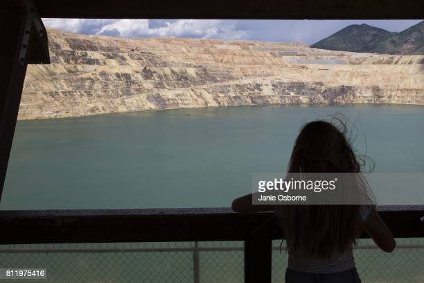 A visitor at the the Berkeley Pit Visitor Information and Viewing Stand takes a look at the toxic Berkeley Pit on July 6 2017 in Butte Montana...