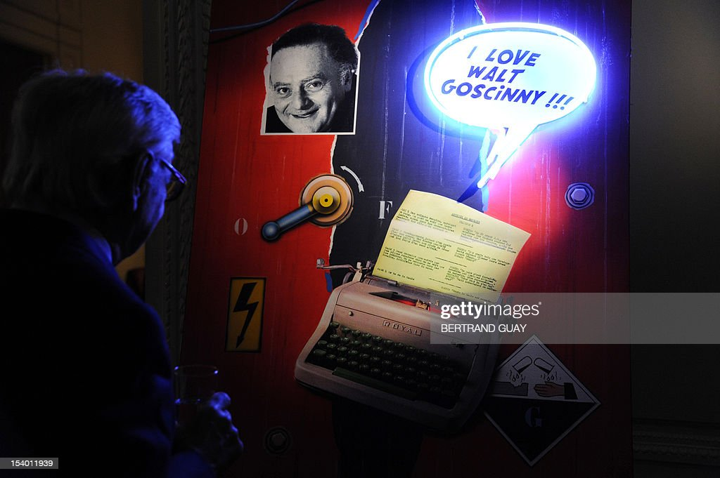 A visitor attends an exhibition dedicated to French cartoonist Rene Goscinny on October 12, 2012 in Paris, as part of the publishing of a book of Gosciny's caricatures entitled 'Mille et un visages de Gosciny' by Jose-Louis Bocquet.