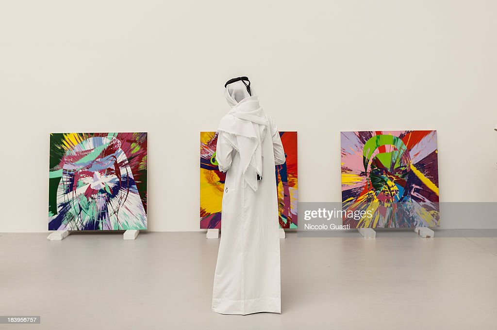 A visitor attends the Relics Exhibition by Damien Hirst at Al Riwaq space next to Doha's Museum of Islamic Art on October 9, 2013 in Doha, Qatar.