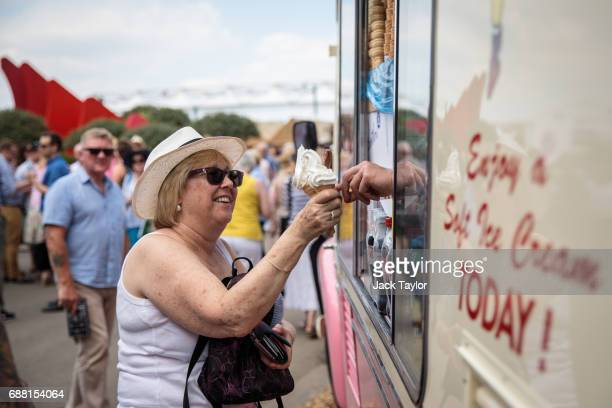 A visitor buys an ice cream at the Chelsea Flower Show on May 25 2017 in London England Visitors enjoy warm weather and blue skies at the prestigious...