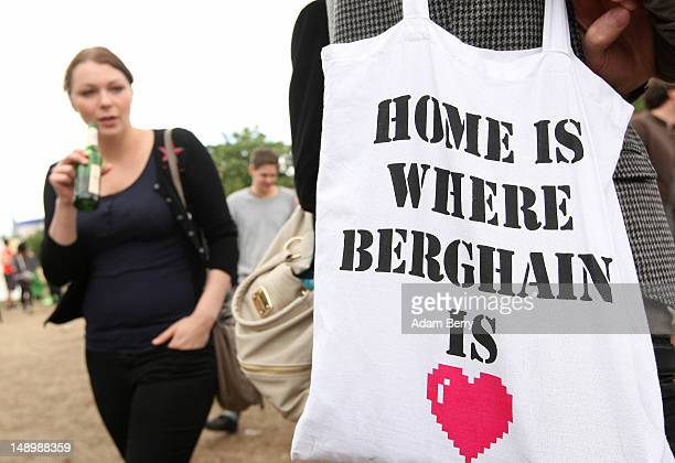 A visitor carries a cloth tote bag advertising the Berlin dance club Berghain during the second annual Hipster Olympics on July 21 2012 in Berlin...