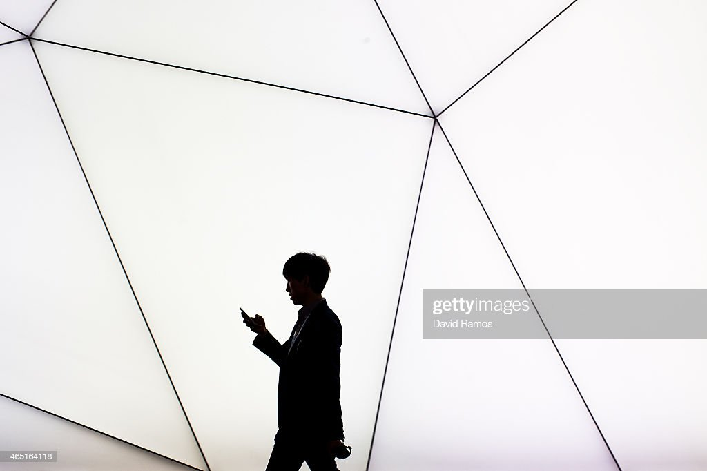 A visitor checks her phone during the second day of the Mobile World Congress 2015 at the Fira Gran Via complex on March 3, 2015 in Barcelona, Spain. The annual Mobile World Congress hosts some of the wold's largest communication companies, with many unveiling their latest phones and wearables gadgets.
