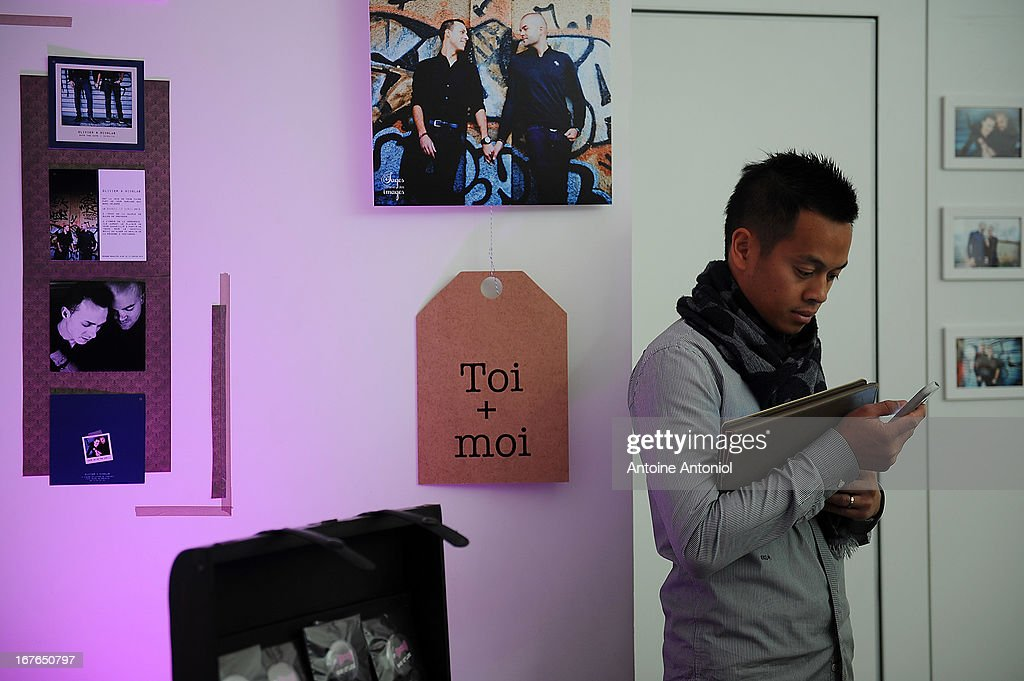 A visitor checks his mobile phone at the gay marriage show on April 27, 2013 in Paris, France. The show takes place four days after France legalised same-sex marriage at the National Assembly.