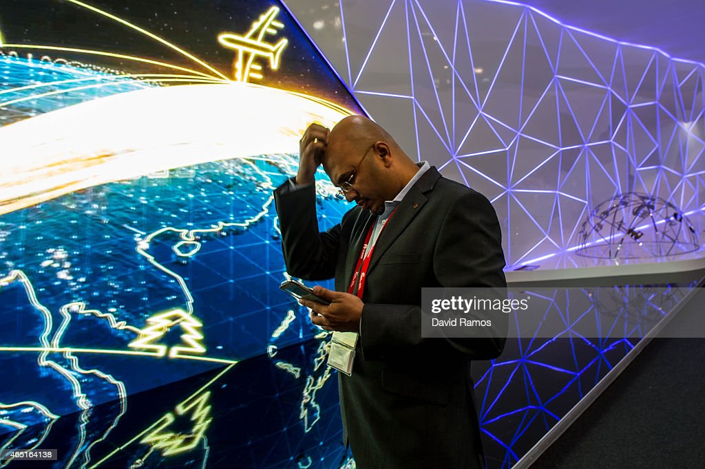 A visitor checks his phone during the second day of the Mobile World Congress 2015 at the Fira Gran Via complex on March 3, 2015 in Barcelona, Spain. The annual Mobile World Congress hosts some of the wold's largest communication companies, with many unveiling their latest phones and wearables gadgets.